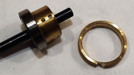 Spur gear collar after removal. Note the thin inner bridge of brass that has been cracked to remove the collar.